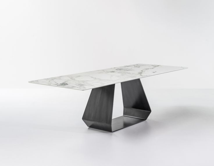 """The """"techie"""" business man lives in a super modern apartment in Milan. For his house he has chosen AX with Calacatta ceramic top and pickled finish metal base: an elegant and particularly innovative choice. Marble is undoubtedly one of the hottest trends of 2016. #bonaldo #adv #AX #ceramic #calacatta #techie"""