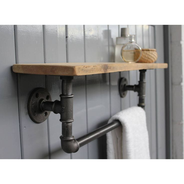An industrial steel pipe storage bar with shelf.Unexpectedly elegant and versatile, our steel pipe shelf can be used for anything from in the bathroom for towels, in the kitchen for pots and pans, or as a coat rack. Comes ready for use with four butcher's hooks included. Lovingly made to order. Wall fittings not included. Please feel free to contact us for advise on the corect fittings for your type of wall. Please do contact us as we can custom make any size according to your own…