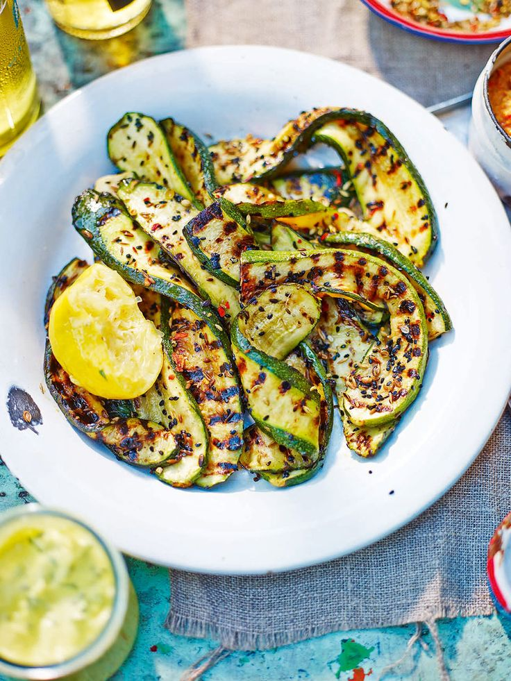Vivek Singh's spiced courgette recipe, served with curried yogurt, is a perfect vegetarian option to cook on the barbecue.