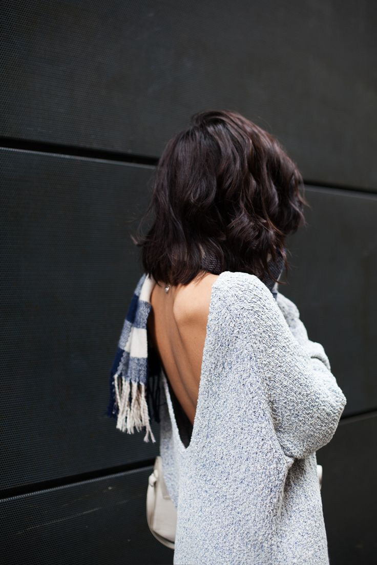 Backless grey sweater with a plaid scarf. We're in love.