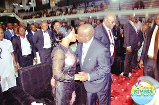 Governor Wike And His Wife Are At It Again See What They Were Seen Doing   Governor Nyesom Wike and his wife Eberechi Suzzette who are known for their public display of affection were at it again at opening ceremony of the 56th Annual General Conference of the Nigerian Bar Association Sunday in Port Harcourt Rivers state.  The Rivers First couple shared a kiss and were all touchy -to the delight of others at the event.  Amebo Corner