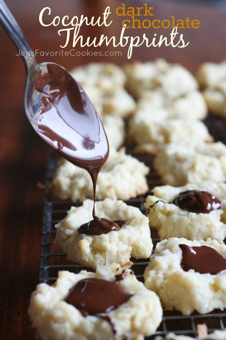 Heavy coconut thumbprint cookies filled with dark chocolate.