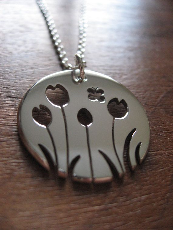 This tulip pendant is handmade using argentium silver. It is approximately 2.5cm across and 1.2mm thick.  I really like doing nature inspired