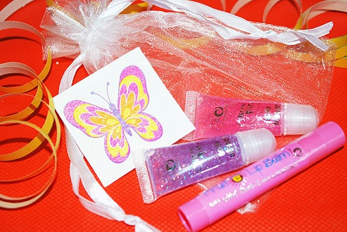 A sweet little going-home gift - and the organza bag may be used for storing precious things afterwards. The bag contains a Miners Strawberry Fruit E Lip Balm (made with added vitamin E and sunscreens); two Miners Glitzy Kitz mini body glitters and a temporary glitter butterfly tattoo £2.50