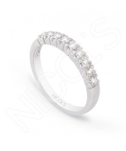 """Anillo de Compromiso Diamantes Aniversario. Media alianza de diamantes talla brillante en garritas en línea. Fabricada en oro blanco con 9 diamantes, con un peso de 0.45ct. """"Un anillo para recordar los 9 momentos maravillosos de tu vida. """""""