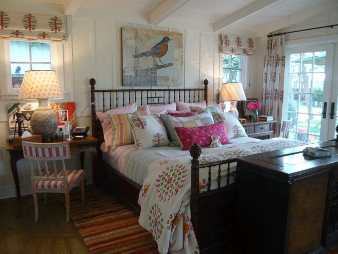 Kathryn Ireland is one of my favorite designers. I love the cottage-feel of the planked walls & white painted beams. And I bet there is a flat screen on hydraulics in that chest at the foot of the bed.