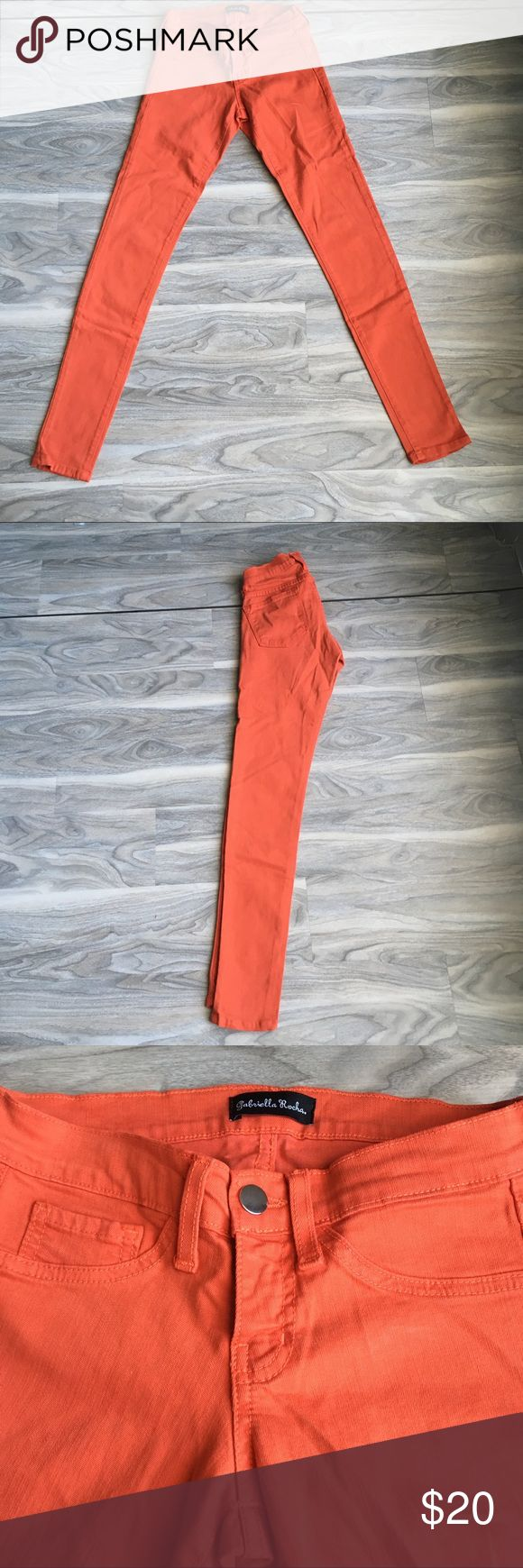 "Orange Skinny Jeans Super cute and bright orange skinny pants size 0. Slightly stretchy. Great for summer. In great condition. Unsure of brand. Made in USA. Waist 25"" inseam 29"" Pants Skinny"