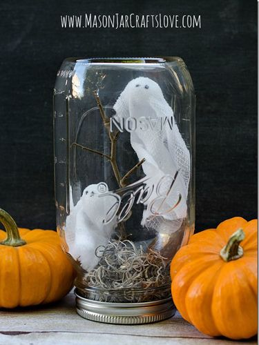 Pick up some Styrofoam, twigs, moss, and gauze, and turn an old Mason jar into a ghostly scene.
