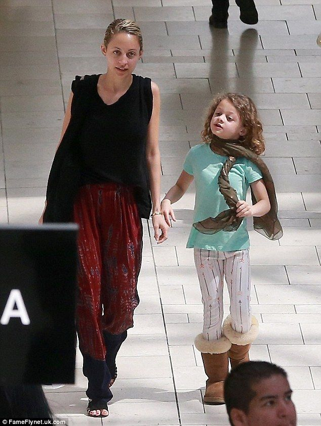 Big day out:Nicole Richie appears to be passing on her sartorial baton to her eight-year-...