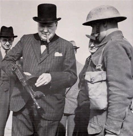 Winston Churchill holding a Thompson Submachine Gun and smoking a cigar- 1940 : OldSchoolCool