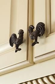 rooster kitchen pulls. Not for all of the cabinets though. Maybe just the uppers, or the 2 drawers?