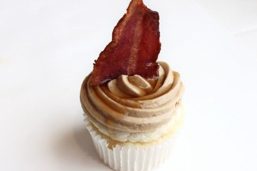 Buttermilk pancake cupcake with maple buttercream frosting topped with bacon
