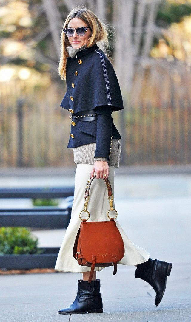 On Olivia Palermo: Burberry Wool Silk Military Cape Coat($1295) and The Bridle Bag; Isabel Marant Cluster Boots($835).