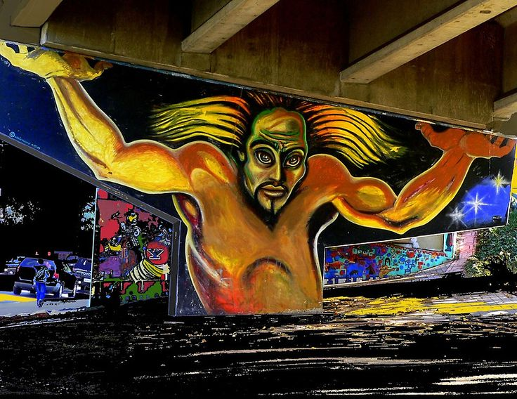 Holding up the overpass in the Barrio Logan section of San Diego, California, are the colorful Murals of Chicano Park. This mural is entitled Colossus. by painting sheep