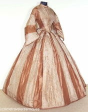 1864 Civil War Era lady's one piece dress in a striking brown striped watered silk taffeta print. A lined and stayed bodice with a front opening with no fasteners, a V back construction with a split tail and deep front points, piped at the armscyes of the pagoda sleeves, and trimmed in a silk roping that repeats at the waist. An unlined skirt, directionally box pleated at the waistband, with a turned hem and a twill tape floor brush