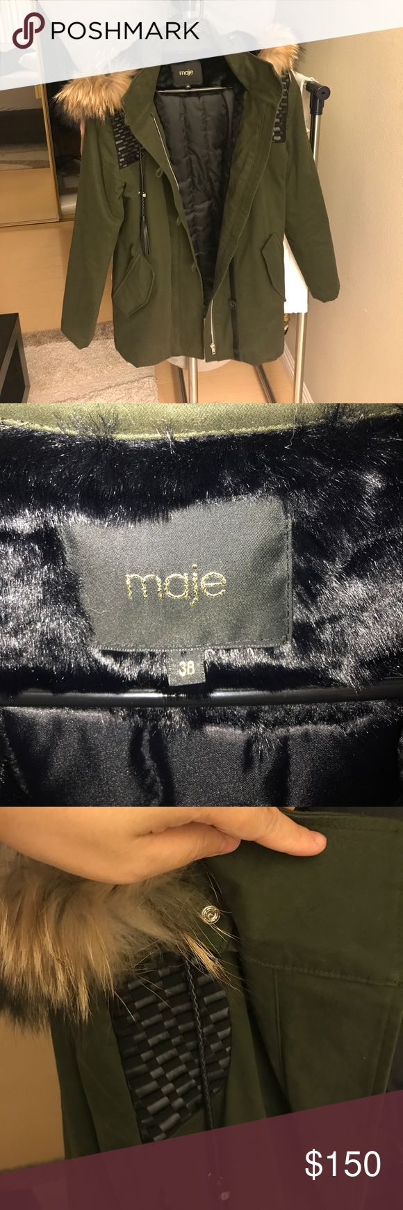 Maje army green parka fur jacket size 38 M Parka with braided details GOVE. Crafted in cotton canvas, the parka is adorned with contrasting woven yokes at the shoulders. It features a high collar, slit flap pockets and a wide fur-trimmed hood embellished with a tasselled cord. It has a zip fastening hidden under a button placket at the front. The piece also sports a removable real animal fur and quilted fabric lining. Combining style and comfort, the parka will keep you warm all season long…