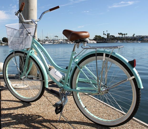 SOLD OUT Limited edition pearl mint green beach cruiser bicycle is in high demand, and for good reason. We've taken the mint green beach cruiser to another level with a beautiful pearlescent mint green paint. The brown saddle and hand grips compliment the bike perfectly giving this beach cruiser a timeless and classy look. Front basket, rear cargo rack, water bottle holder and water bottle are included  ✔ Nationwide shipping available on all of our bikes