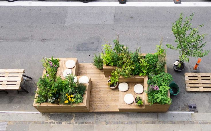 Urban seating area incorporating plant life. This is more of an intimate space for close friends and family.