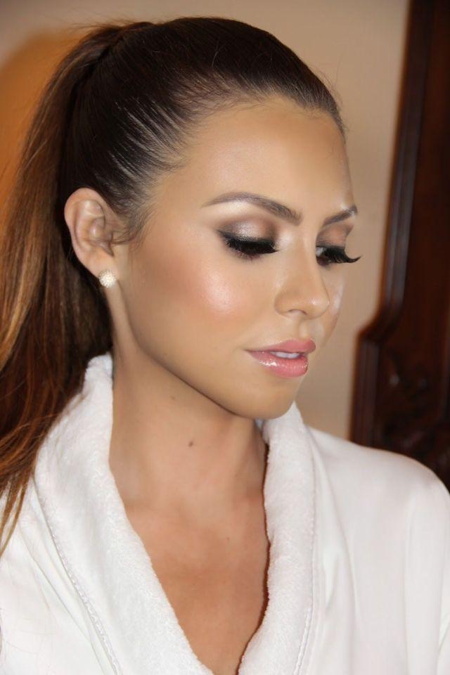Bronze skin, smokey eyes, pink lips = the perfect glamorous makeup for your wedding. Image via Buzzfeed