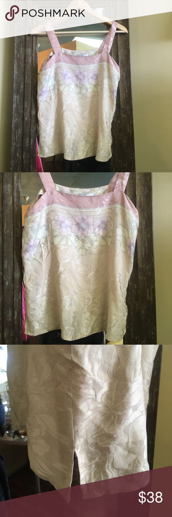 Vintage silk floral cami top Omg ! Awesome vintage silk floral cami top .. This awesome top has side zip with two pleats on either side it is pink and cream colored a must have this summer sz small straps have been taken in but has 3to 4 inches if need additional room to let out vintage Tops Camisoles