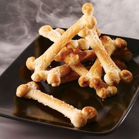 Easier than it looks! These salty bones can be made with refrigerated bread stick dough. Just slit them a bit on each end, and then fold the flaps to look like the end of a bone, bake and serve them with a bowl of warm soup!