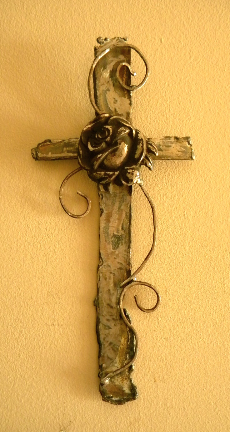 A cross made from Alabama tornado scrap iron by artist Catherine Partain of crossesbycatherine.com