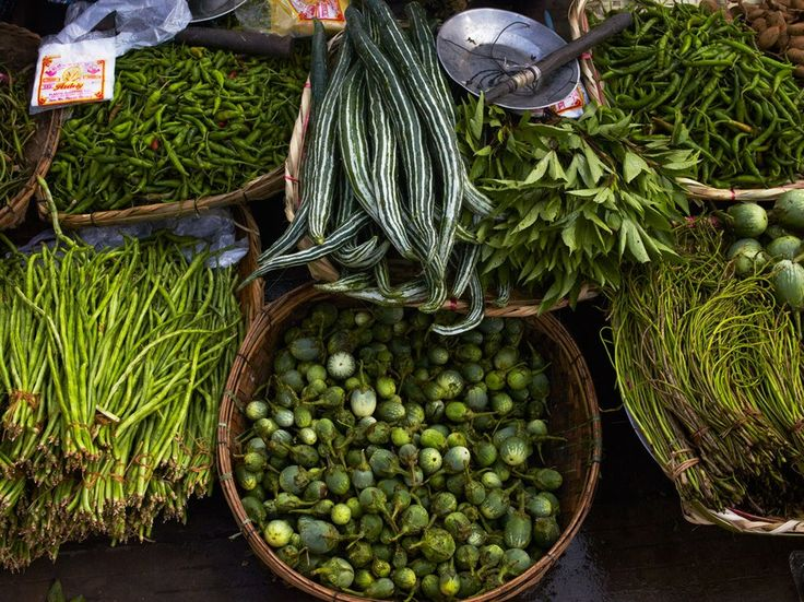Long beans, peppers, and cucumbers at the outdoor market in Sittwe.