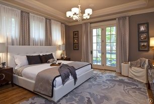 Traditional Master Bedroom with LEANNE PAISLEY PRINT DRAPE, Crown molding, Hardwood floors, French doors, Chandelier