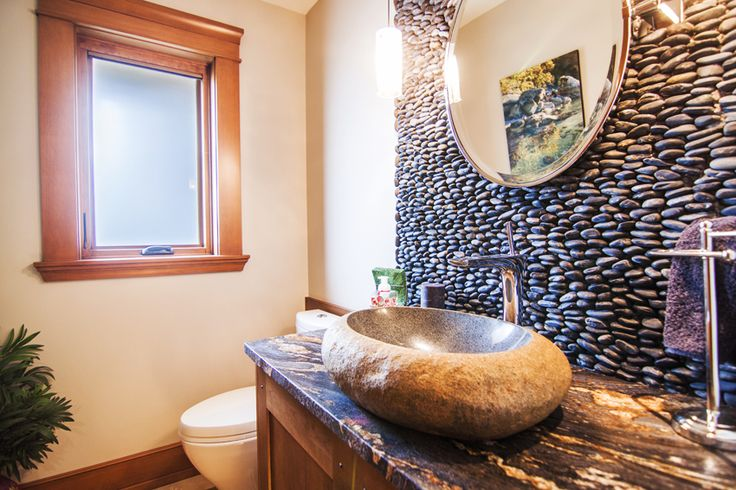 Powder Room Featuring an Organic Boulder Sink Finished with a Stacked Pebble Statement Wall.