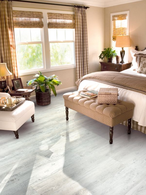 White Wood Effect Vinyl Flooring Brings A Quaint Chic To This Beautiful Bedroom White Wood Floors Bedroom Flooring Luxury Vinyl Flooring