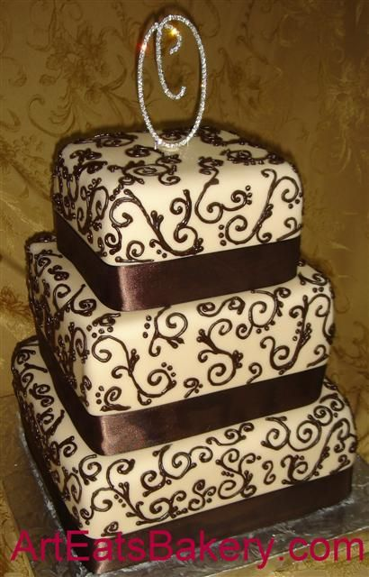 Google Image Result for http://arteatsbakery.com/images/three%2520tier%2520square%2520wedding%2520cake%2520with%2520chocolate%2520brown%2520ribbons%2520and%2520scrolls.jpg