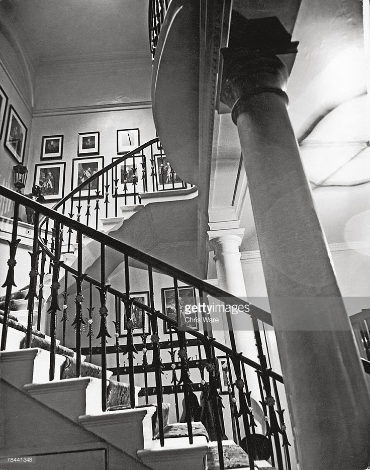 A grand staircase in White's gentleman's club in St James' Street, 6th January 1949. Founded by Fred White in 1693, White's lays claim to being the oldest club in London.