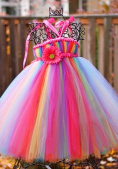 Rainbow Bright Tutu Dress 20/30length Receive by March1st This listing is for our RAINBOW BRIGHT TUTU DRESS. Made with tons of tulle in a fabulous combination of all the colors of the rainbow, this sweet number will be perfect for your little gals birthday, parties, and photos ops! This dress has a removable elastic waistband that is not sewn on, so you can adjust it to the best fit for your little one. It can also be removed completely so the tutu can be worn as a skirt later on. *I can...