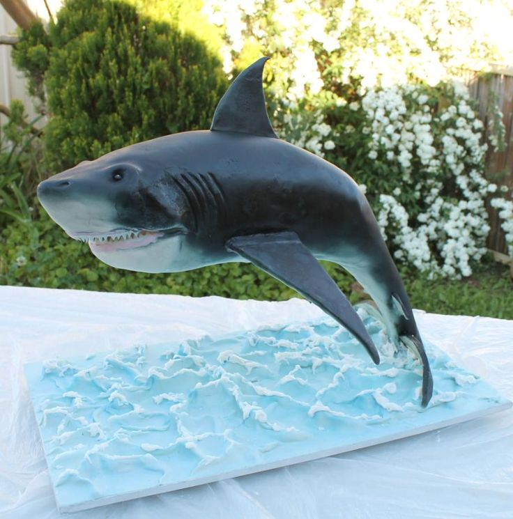 Introducing my shark He weighs in at a massive 15kgs and measures 80cm from the tip of his nose to the base of his tail. I had such a great time creating him. He is completely edible, apart from the internal support. This was made during a two day...
