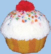 """Huggables Sweet Treat Cupcake Pillow 12x9"""". A great pillow for a kids bedroom or play room. Kit includes 5 mesh rug canvas, chart, 100% acrylic pre-cut yarn and complete assembly instructions. Assembly required. Stuffing and latch hook tool not included. Savor the Sweet Cupcake!"""