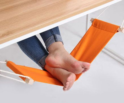 Kick back on casual Fridays while you toil away at endless TPS reports with the foot rest hammock at your desk.This small hammock attaches to each end of the desk and is completely adjustable to fully suit your lounging needs.