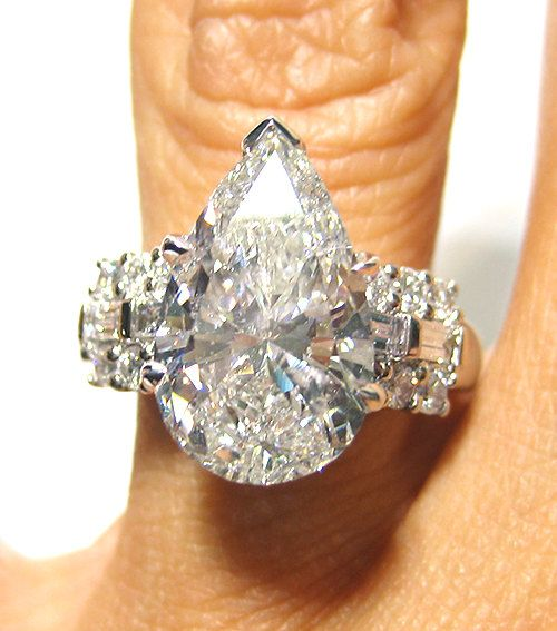 Items similar to 4.58ct PEAR shaped Diamond ring with side diamonds in 18k WHITE GOLD on Etsy. , via Etsy.