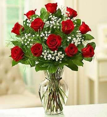 Classic long stem red roses in glass  vase. Women feel very special when they get fresh flowers that say I love you just because.  Orchids, colorful arrangements they are all signs of love that help her just feel she is blessed to have a man who cares.