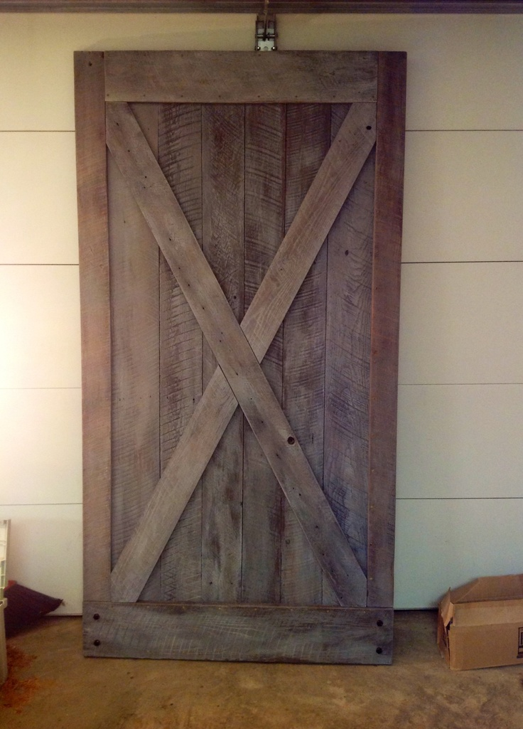Sliding Barn Door made from Scratch by Charlie  using old weathered barn-wood from our lumberyard, salvaged from century old barns in the Middle TN area.