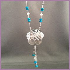 'Drops of Clear Blue Sky' necklace - A hand finished sterling silver drop necklace, decorated with fine line work reminiscent of hummingbird flying through a clear blue sky, and accented with the summer blue of turquoise, softened with a few pearl beads . A bit of the South West. A bit of Gatsby. A lovely swing to every move you make. Suspended from a 24 inch chain. Buy for $128.45 at http://mosadijewelry.com/collections/mosadi-necklaces/products/drops-of-clear-blue-sky