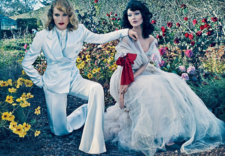 ROLE REVERSALThe androgyne entrances, the belle enchants. On Amber: Ralph Lauren Collection satin blazer ($2,898), silk shirt ($1,298), and wide-leg trousers ($1,698); select Ralph Lauren stores. On Shalom: Oscar de la Renta pleated silk-tulle dress with – Vogue