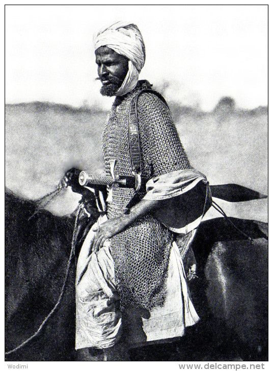 Mounted Sudanese warrior, late 1800s, wearing a long, heavy, mail hauberk and carrying a kaskara sword. It has been suggested that this may be Muhammad Ahmad (the Madhi), the leader of the Sudanese Islamic state who fought for independance from Khedival Egypt.