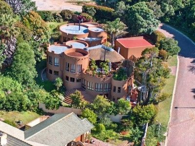 """A unique private sanctuary, tucked away at The Heads in Knysna, a rarity in the real estate market - a true once in a lifetime property! Aptly names """"Coney Castle"""" this fairy-tale home abounds with character, warmth and charm."""