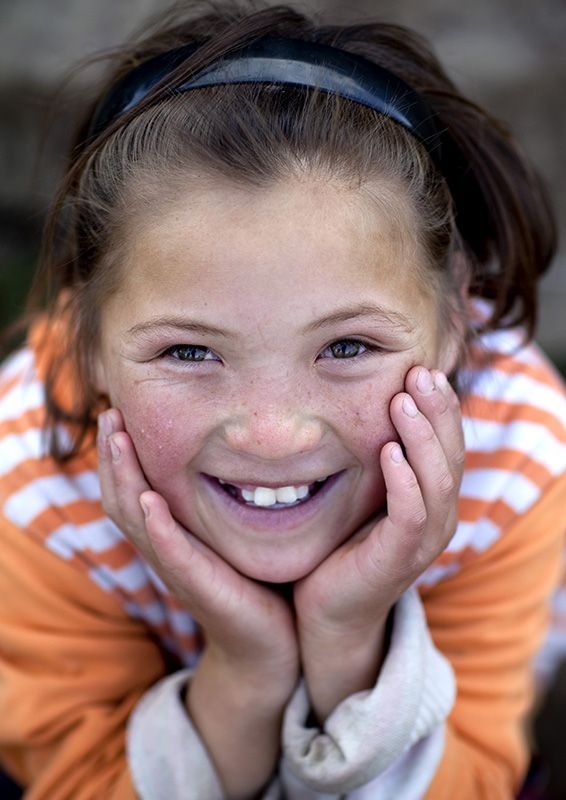 Smiling kid in Kyrgyzstan by Eric Lafforgue