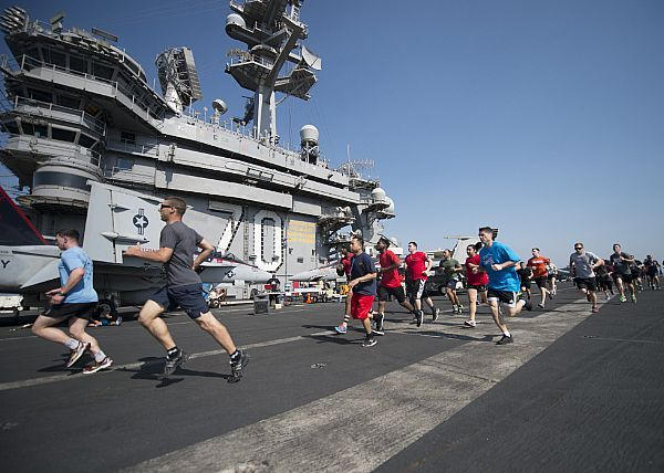 Sailors participate in the Martin Luther King Jr. 5K run on the flight deck of the aircraft carrier USS Carl Vinson.