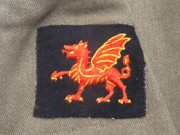 WWI Officer's Tunic, 38th Welsh Division with wound strip on right forearm.