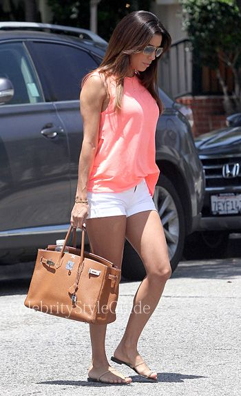Seen on Celebrity Style Guide: Eva Longoria was dressed for the summer wearing a Lovers + Friends She�s a Woman Tank as she stops by Castle Park in Sherman Oaks to attend her friend's son's birthday party July 12  Get Eva's Top Here: http://rstyle.me/~2eHCQ