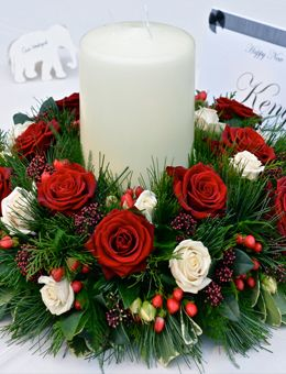 Christmas Table Decorations using Christmas wreath | Wedding flowers, Avington Park, Christmas themed candelabra flowers ...