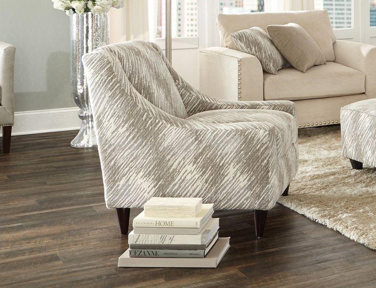 the stylish empire accent chair is upholstered in a textured fabric