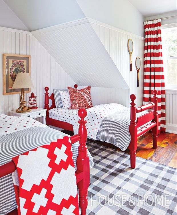 A strict palette of red, white and sky blue helps traditional elements, like ticking, quilts and vintage beds, feel crisp and youthful. | Photographer:  Stacey Brandford  Designer:  Natalie Hodgins and Kate Stewart